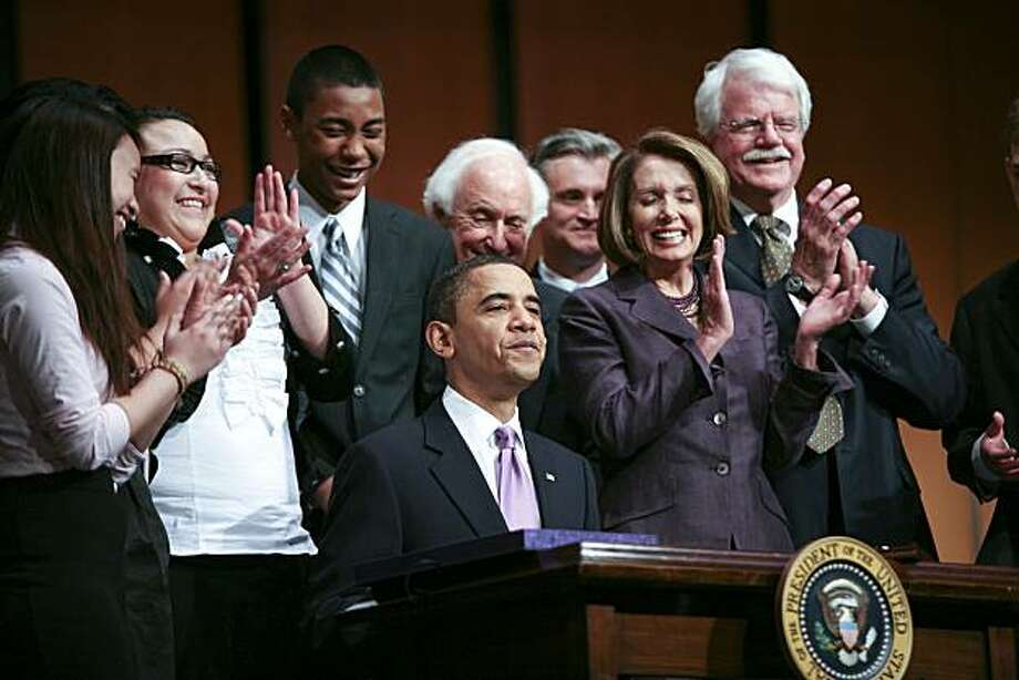U.S. President Barack Obama signs the Health Care and Education Reconciliation Act of 2010 at Northern Virginia Community College with House Speaker Nancy Pelosi, a California Democrat at right in Arlington, Virginia, U.S., on Tuesday, March 30, 2010. Obama today signed the last piece of legislation to enact the U.S. health-care overhaul, a measure that includes changes to student aid programs. Photographer: Gary Fabiano/Pool via Bloomberg *** Local Caption *** Barack Obama; Nancy Pelosi Photo: Gary Fabiano, Bloomberg