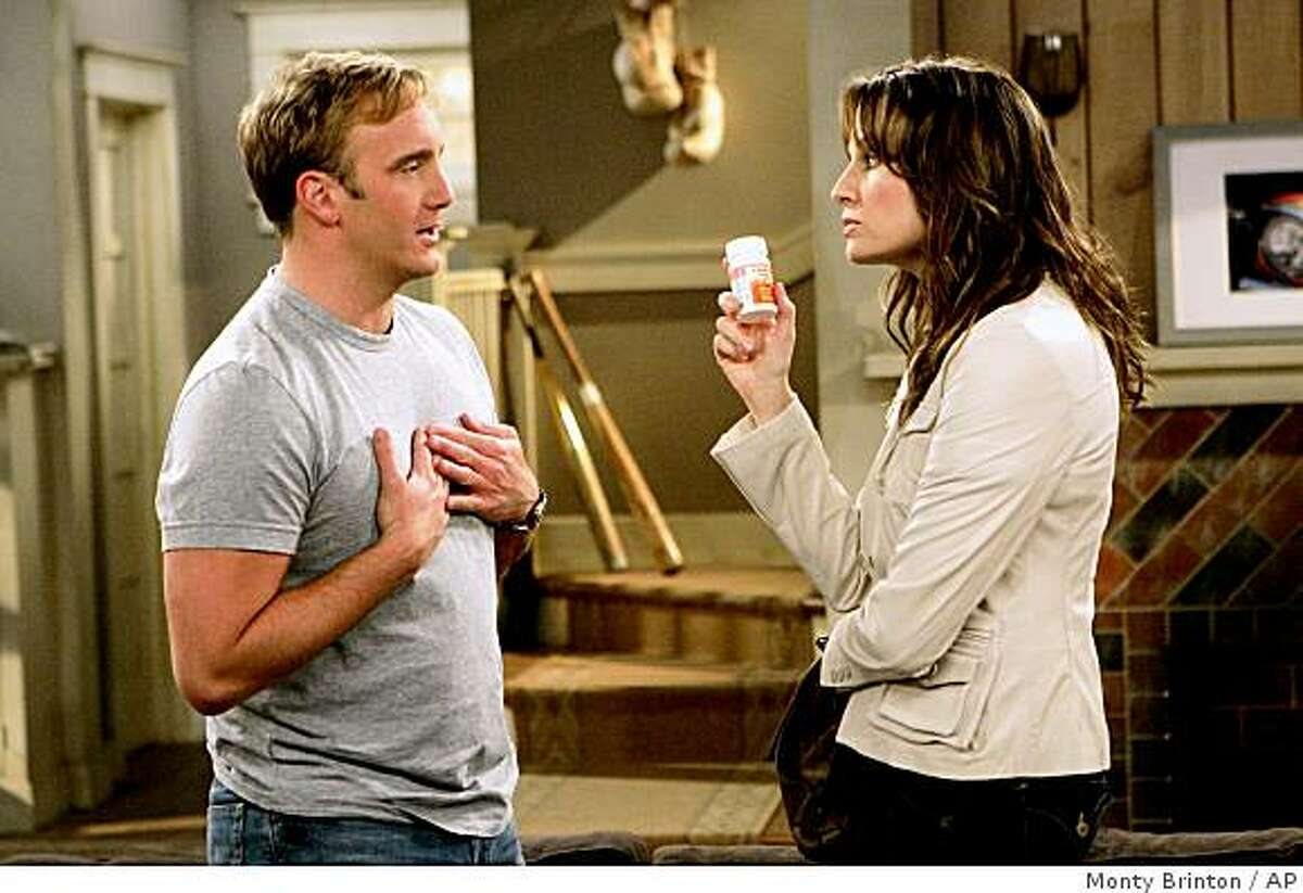 In this image released by CBS, Jay Mohr stars as Gary Barnes, left, and Paula Marshall stars as his controlling ex-wife Allison in a scene from