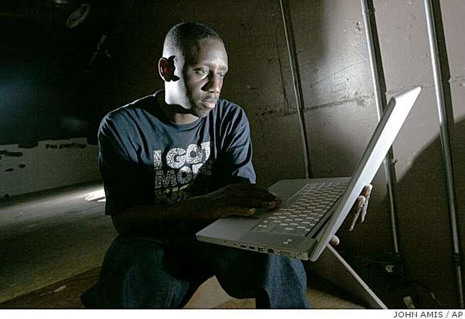 Record producer Chaka Zulu looks through material, created by his artists, to post to YouTube, Tuesday Sept. 2, 2008, in Atlanta. (AP Photo/John Amis) Photo: JOHN AMIS, AP