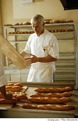 Baking instructor, Steven Isaac, with some freshly baked baguettes from the oven at the San Francisco Baking Institute in South San Francisco, Calif., on September 9, 2008 Photo: Craig Lee, The Chronicle