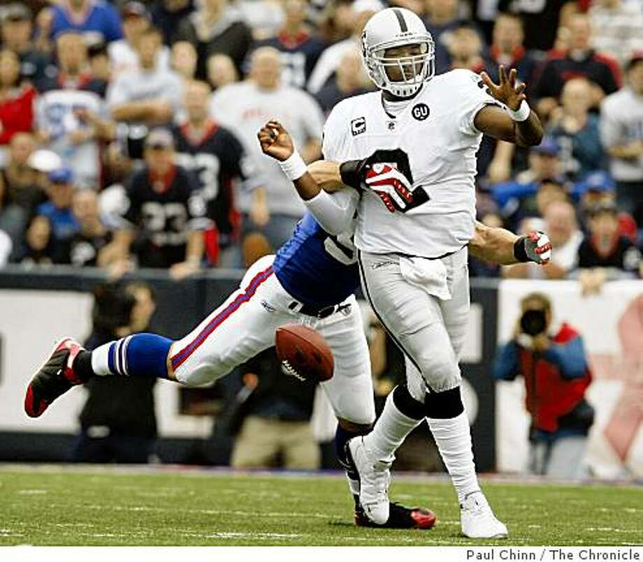 JaMarcus Russell fumbled the ball when Buffalo's Chris Kelsay grabbed him in the second quarter of the Oakland Raiders vs. Buffalo Bills football game at Ralph Wilson Stadium in Orchard Park, N.Y., on Sunday, Sept. 21, 2008. Photo: Paul Chinn, The Chronicle