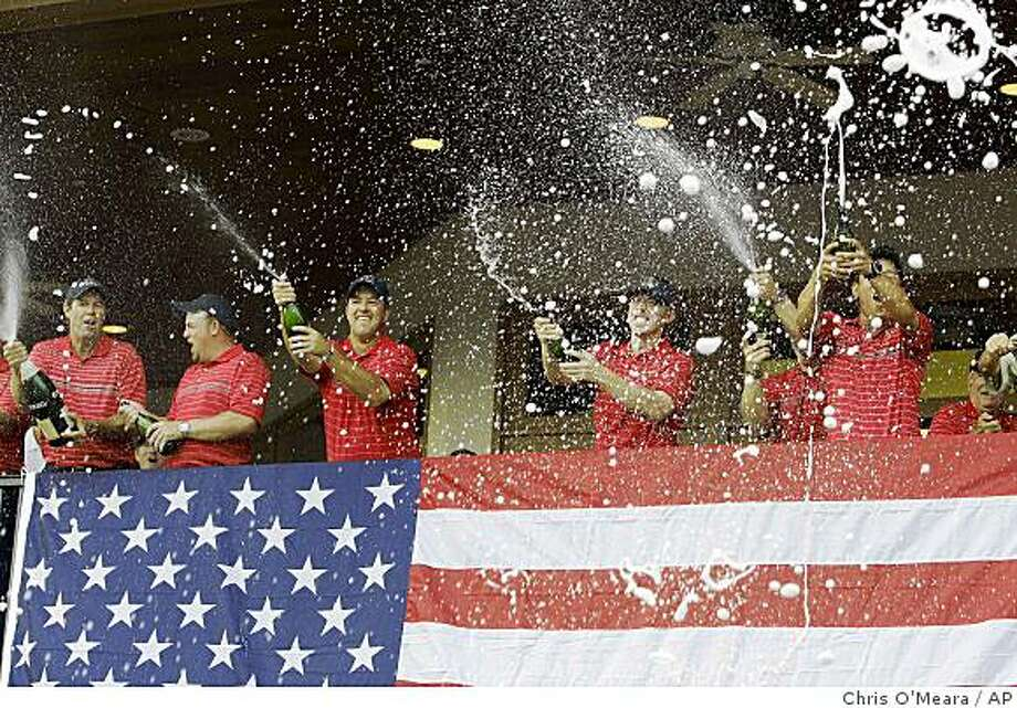 Members of the USA team spray champagne after winning the Ryder Cup golf tournament at the Valhalla Golf Club, in Louisville, Ky., Sunday, Sept. 21, 2008.  (AP Photo/Chris O'Meara) Photo: Chris O'Meara, AP