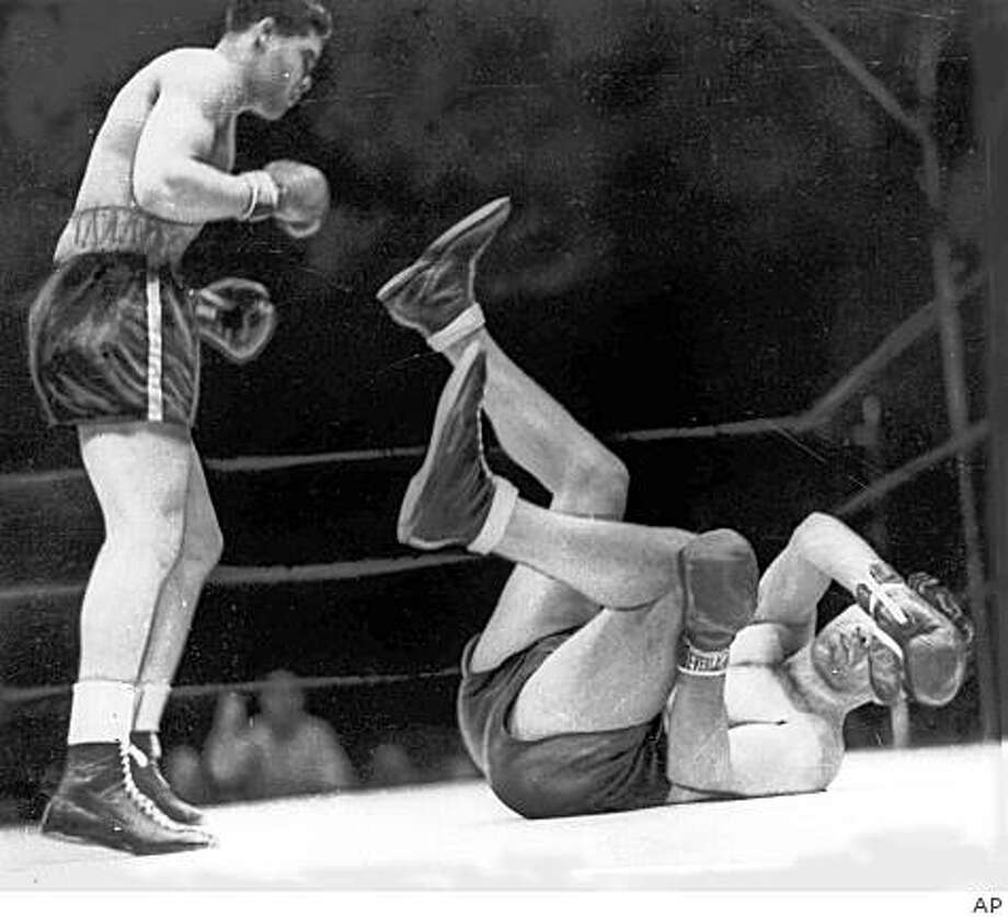 In this June 22, 1938 file photo, boxer Joe Louis, left, knocks out Max Schmeling in the first round to win the heavyweight title at Yankee Stadium in New York. Photo: AP