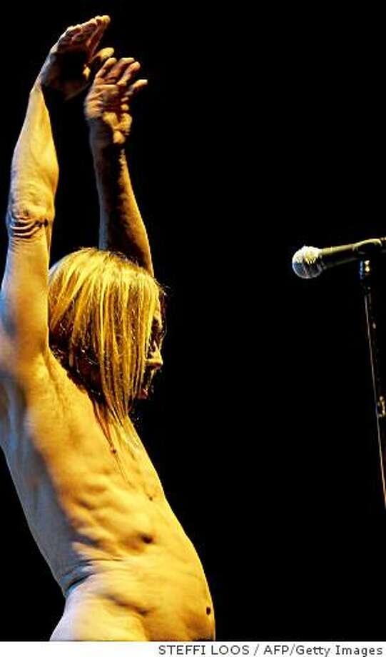US singer Iggy Pop performs on stage with hisa band The Stooges in the western German city of Bochum on September 16, 2008. The concest was the first of two dates in Germany, the second to be played in Hamburg on September 18. AFP PHOTO DDP / STEFFI LOOS   GERMANY OUT (Photo credit should read STEFFI LOOS/AFP/Getty Images) Photo: STEFFI LOOS, AFP/Getty Images