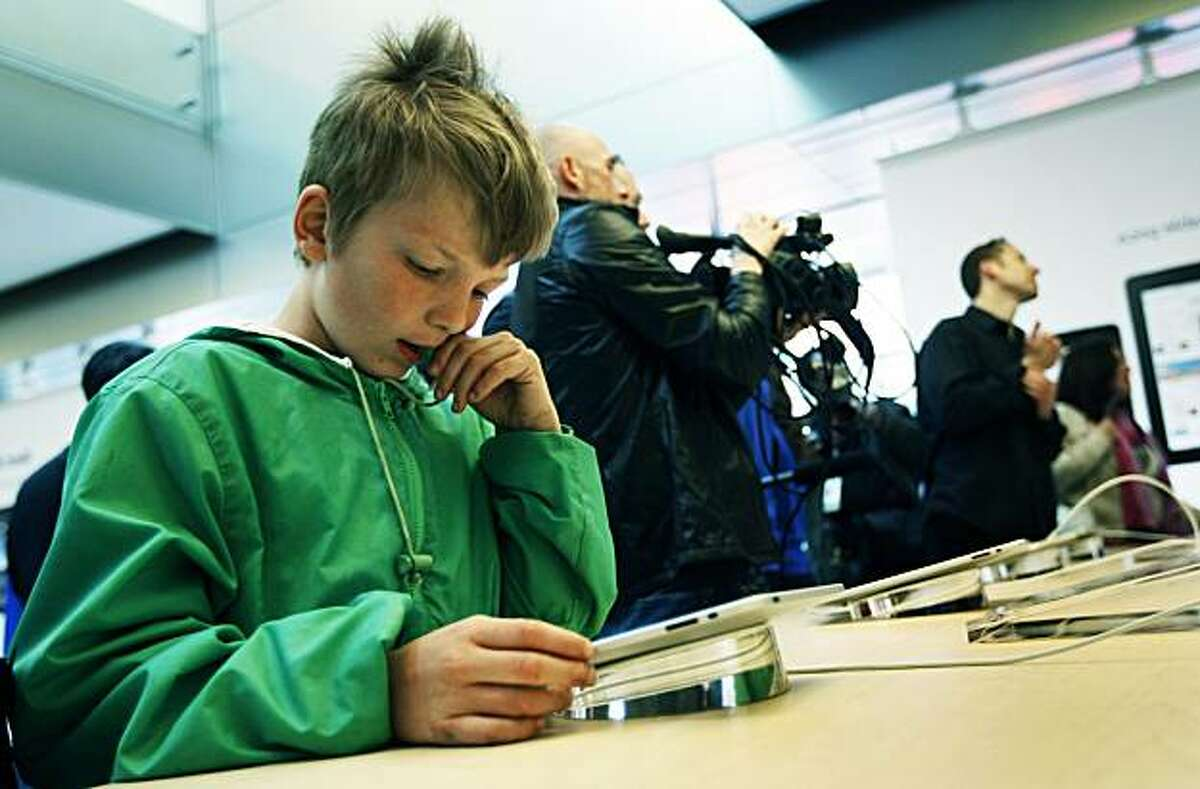 Lyle Kahney age 9 from San Francisco plays a game on an iPad at the Apple Store in San Francisco Saturday April 3, 2010. Kahney was so excited he couldn't wait to use his new IPad at home that his mother just purchased so he started the game on the store display unit.