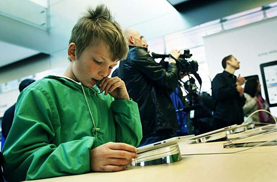 Lyle Kahney age 9 from San Francisco plays a game on an iPad at the Apple Store in San Francisco Saturday April 3, 2010. Kahney was so excited he couldn't wait to use his new IPad at home that his mother just purchased so he started the game on the store display unit. Photo: Lance Iversen, The Chronicle