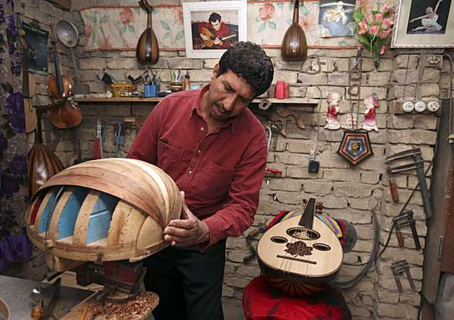 In this photo taken March 1, 2010, Farhan Hassan makes an oud at his workshop Baghdad, Iraq. The oud's angst-filled tunes define Iraq's music, the same way the Tigris and Euphrates rivers define its landscape. But nowadays few in the country play or makethe oud, a pear-shaped, deep-voiced cousin of the lute. Photo: Karim Kadim, AP