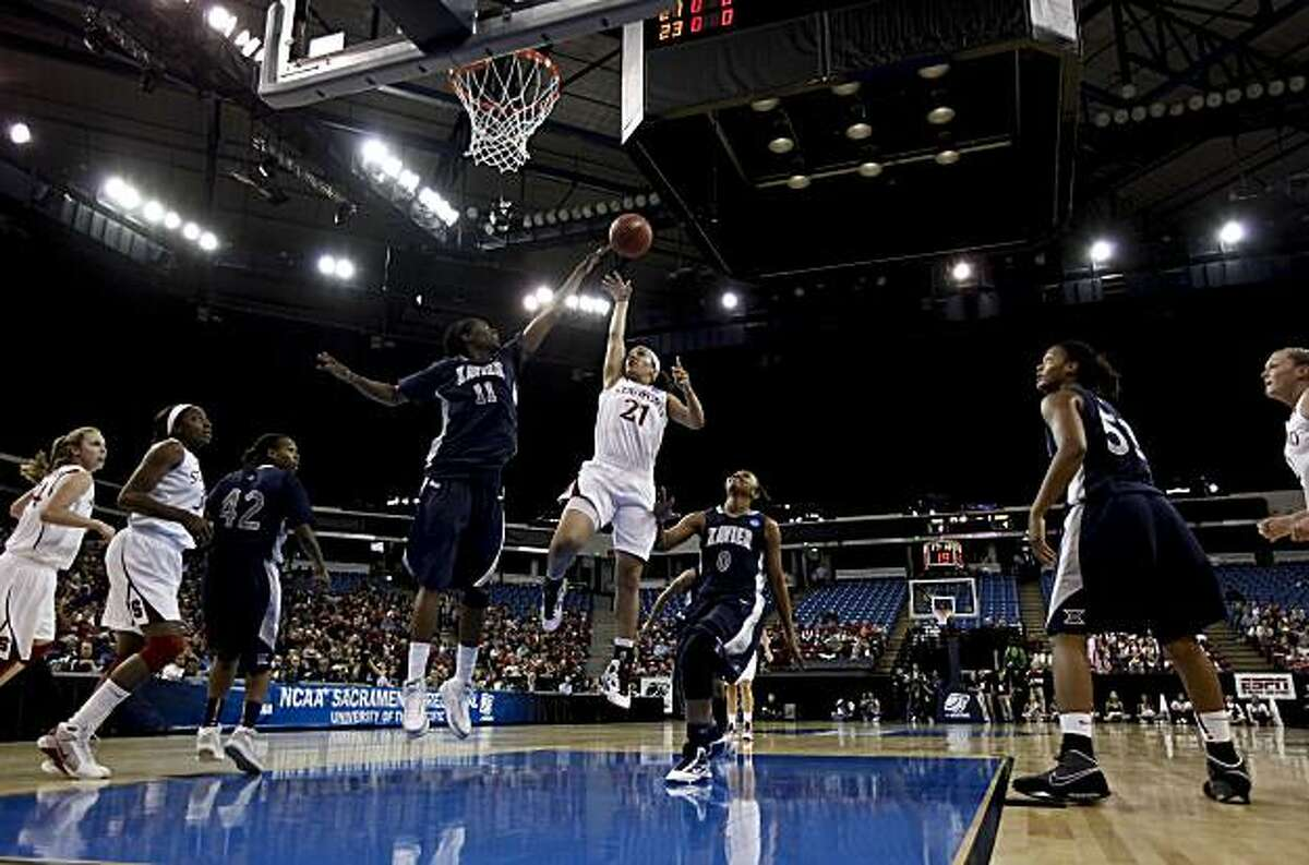 Stanford's Rosalyn Gold-Onwude drives to the basket past Xavier's Amber Harris in the first half as Stanford takes on Xavier in the regional final of the 2010 NCAA Womens Basketball Tournament at Arco Arena in Sacramento on Monday.