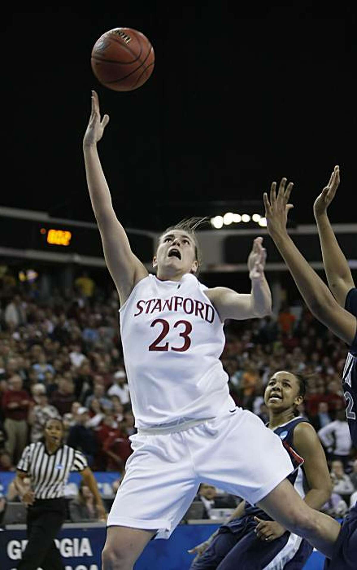 Stanford's Jeanette Pohlen drives inside Xavier's April Phillips for the final basket and the win for Stanford over Xavier in the regional final of the 2010 NCAA Women's Basketball Tournament at Arco Arena in Sacramento on Monday.