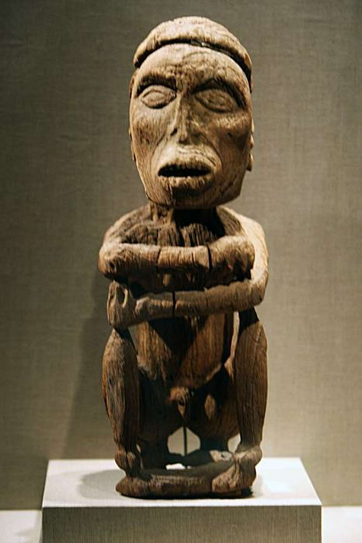 Seated Male Figure made from wood from Geelvink Bay on Biak Island is dated between 1290 and 1410. John Friede - a de Young trustee, donated the Jolika Collection of New Guinean art to the de Young Museum. The collection is now embroiled in an ownership dispute because a week after he gave the collection to the museum, he signed a paper giving the collection to his siblings who want to sell it off. There may also be a dispute from Papua New Guinea who might lay claim that the pieces were improperly taken from the country. Photographed in San Francisco Friday Sept 19, 2008.