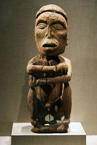 Seated Male Figure made from wood from Geelvink Bay on Biak Island is dated between 1290 and 1410. John Friede - a de Young trustee, donated the Jolika Collection of New Guinean art to the de Young Museum. The collection is now embroiled in an ownership dispute because a week after he gave the collection to the museum, he signed a paper giving the collection to his siblings who want to sell it off. There may also be a dispute from Papua New Guinea who might lay claim that the pieces were improperly taken from the country. Photographed in San Francisco Friday Sept 19, 2008. Photo: Lance Iversen, The Chronicle