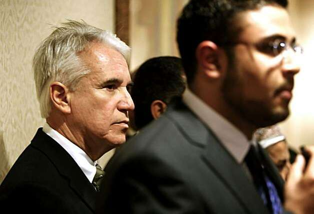 San Francisco Police Chief George Gascon, left, listens to Adel Syed, the coordinator of the California Council on American-Islamic relations. Gascon spoke to members of San Francisco's Muslim community Friday, continuing his apology tour over comments he made about terrorism. Photo: Michael Macor, The Chronicle