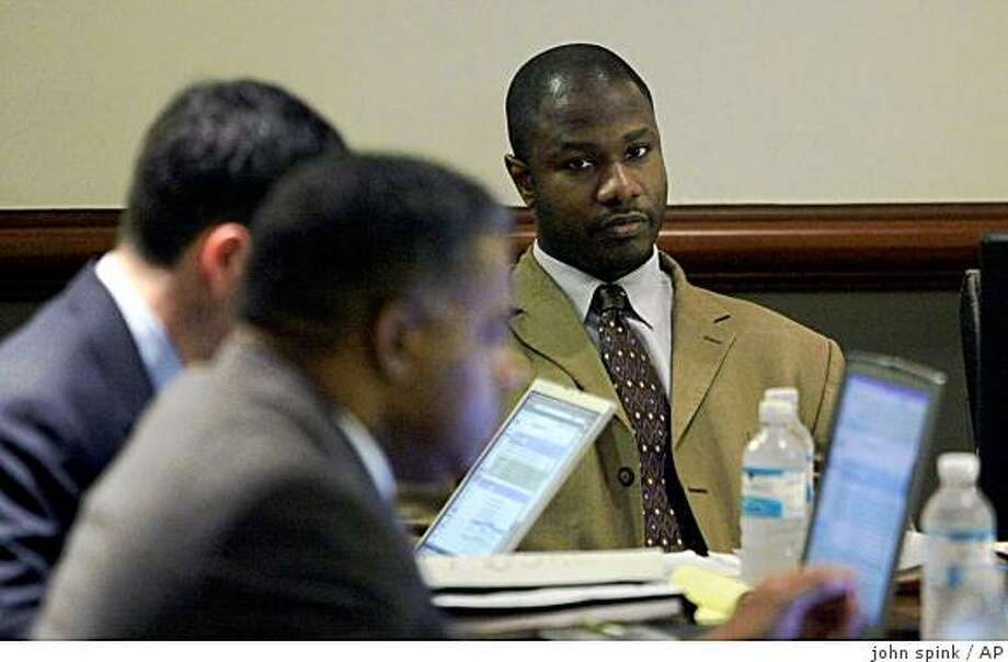 Brian Nichols, left, sits with his defense team Monday Sept. 22, 2008,as his trial gets underway three years after the accused rapist escaped from the Fulton County Courthouse and allegedly went on an  shooting spree in 2005. Nichols, 36, is pleading not guilty by reason of insanity. Prosecutors are seeking the death penalty forNichols, who is accused of killing a judge, court reporter and sheriff's deputy at the Fulton County Courthouse, and a federal agent later that day.(AP Photo/John Spink ,Pool) Photo: John Spink, AP