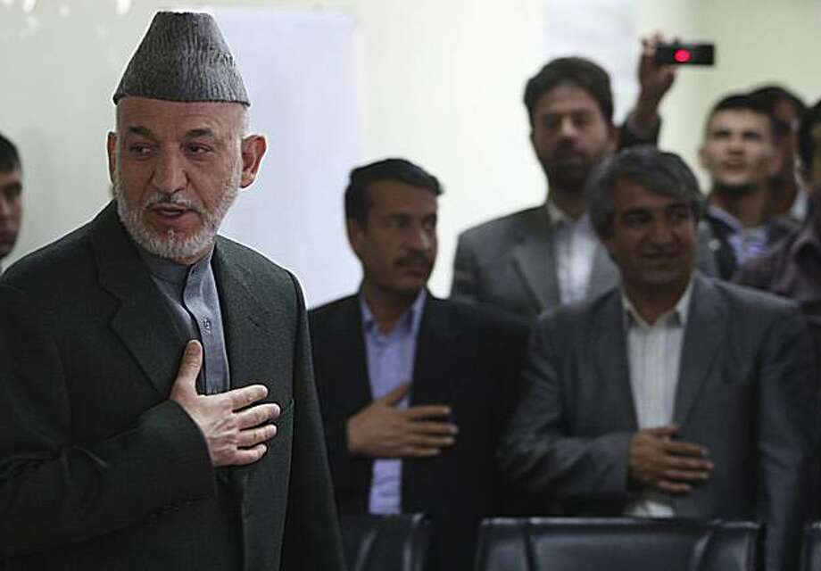 """Afghan President Hamid Karzai, left, is greeted by Election Commission officials during his visit to the Election Commission office in Kabul, Afghanistan, Thursday, April 1, 2010. Karzai told election workers Thursday there had been """"vast fraud"""" in the Aug. 20 ballot but that it was not committed by Afghans. Photo: Rafiq Maqbool, Associated Press"""