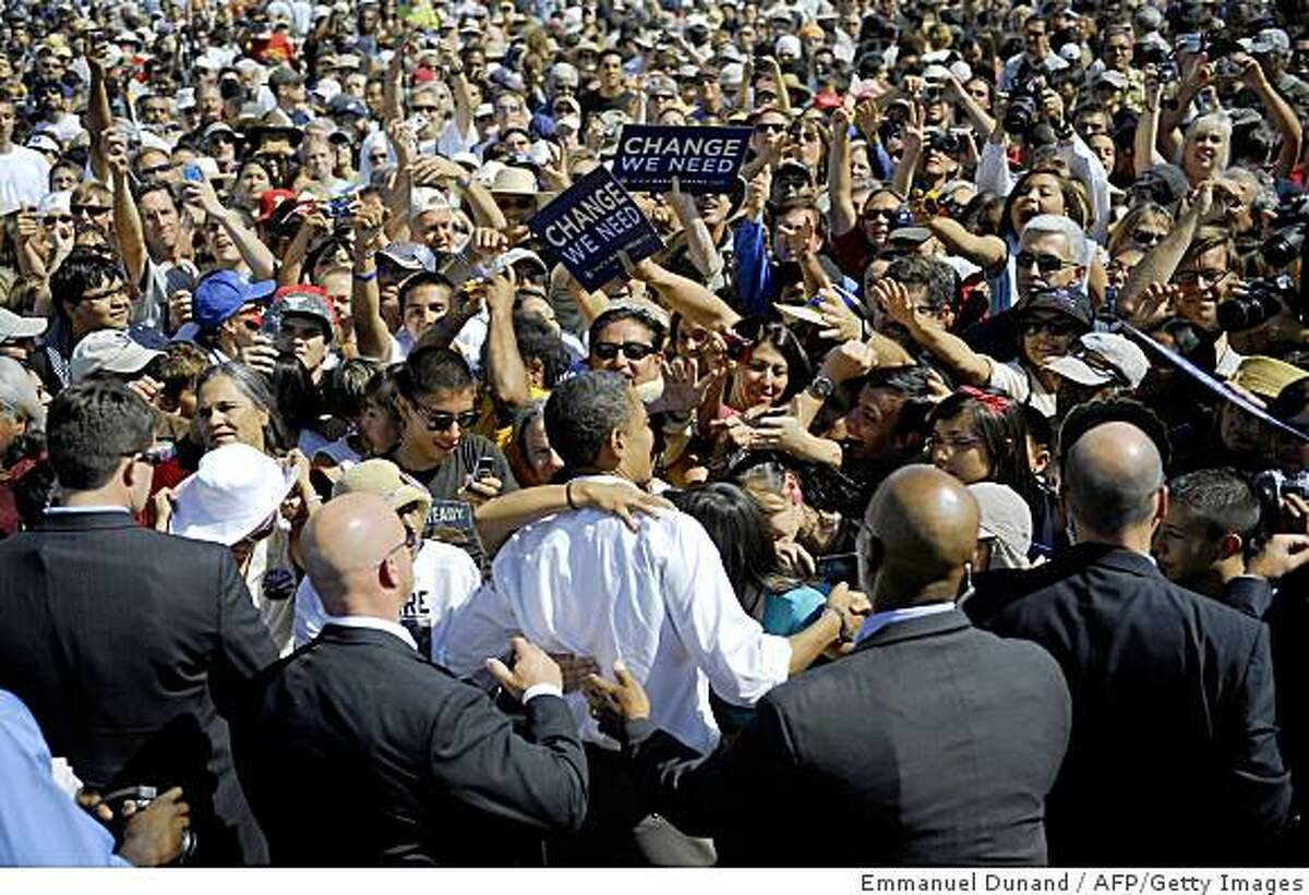 US Democratic presidential candidate Illinois Senator Barack Obama greets supporters at the end of a rally at Plaza de Espanola in Espanola, New Mexico, September 18, 2008. AFP PHOTO/Emmanuel Dunand (Photo credit should read EMMANUEL DUNAND/AFP/Getty Images)