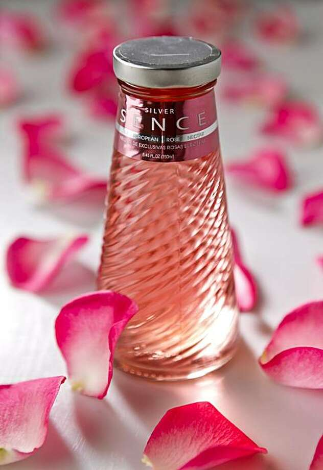 Rose essence drink with rose petals Photo: Russell Yip, The Chronicle