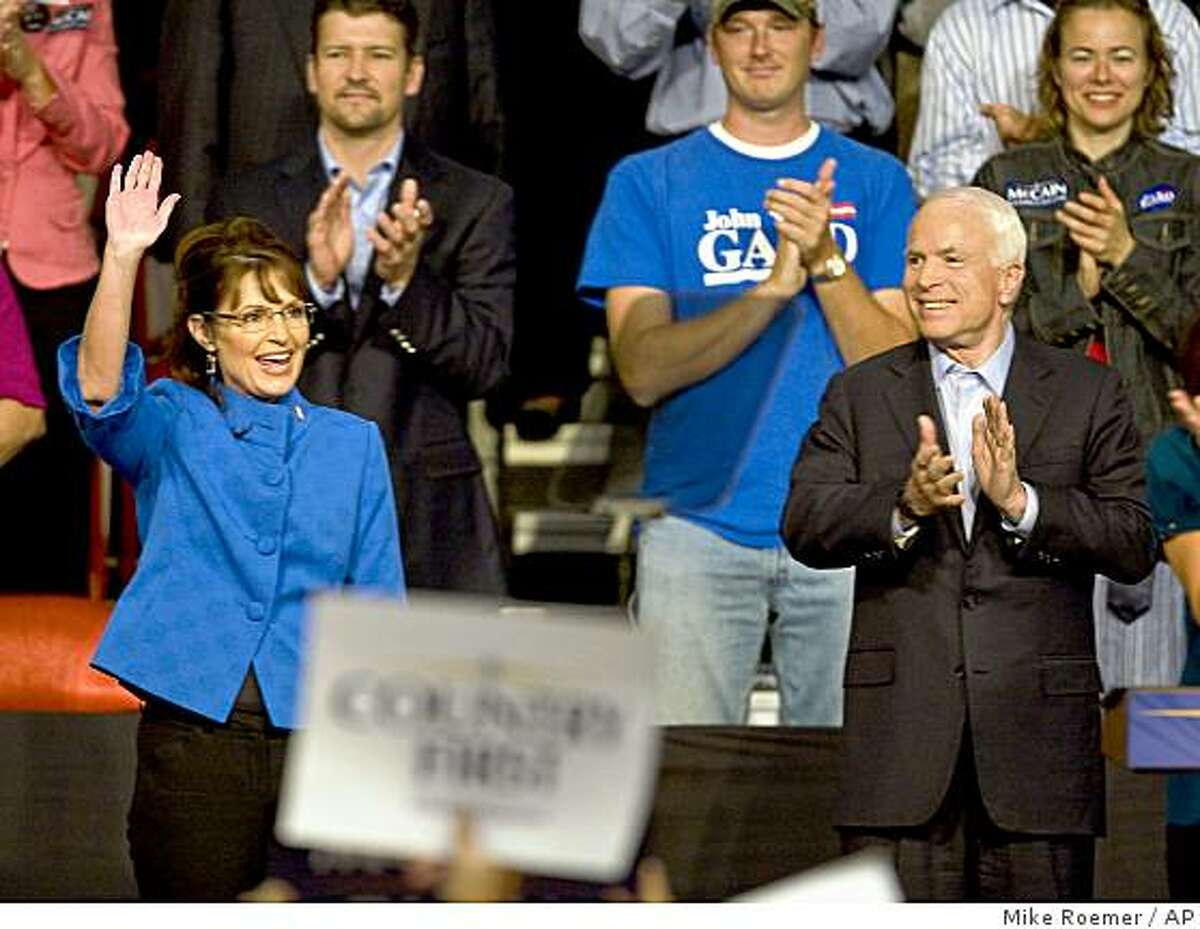 Republican presidential candidate, Sen. John McCain, R-Ariz., and his vice presidential running mate, Alaska Gov. Sarah Palin, greet supporters during a rally, Thursday, Sept. 18, 2008, in Green Bay, Wis.. (AP Photo/Mike Roemer)