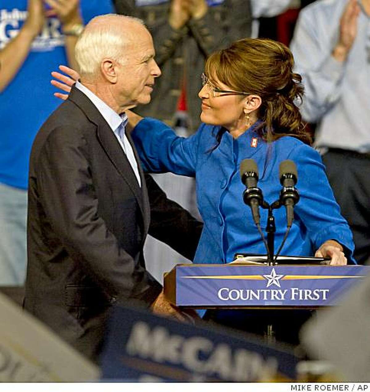Republican presidential candidate, Sen. John McCain, R-Ariz., hugs vice presidential running mate, Alaska Gov. Sarah Palin, during a rally, Thursday, Sept. 18, 2008, in Green Bay, Wis.