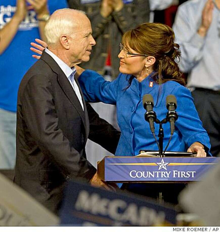 Republican presidential candidate, Sen. John McCain, R-Ariz., hugs vice presidential running mate, Alaska Gov. Sarah Palin, during a rally, Thursday, Sept. 18, 2008, in Green Bay, Wis. Photo: MIKE ROEMER, AP
