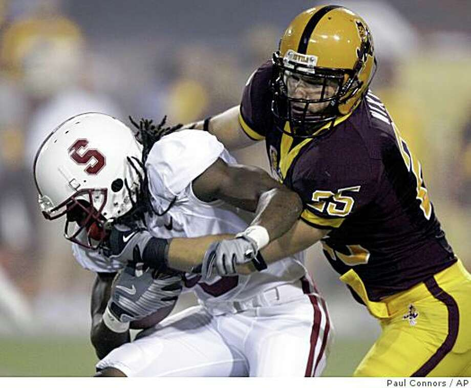 Stanford wide receiver Richard Sherman, left, is hauled down from behind by Arizona State linebacker Mike Nixon in the first quarter of an NCAA football game Saturday, Sept. 6, 2008, in Tempe, Ariz. (AP Photo/Paul Connors) Photo: Paul Connors, AP