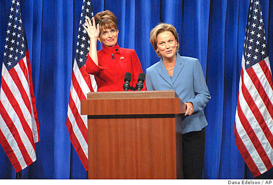 """In this photo provided by NBC, actress Tina Fey, left, plays Governor Sarah Palin, and actress Amy Poehler plays Senator Hillary Clinton on """"Saturday Night Live"""" Saturday, Sept. 13, 2008 in New York. Photo: Dana Edelson, AP"""