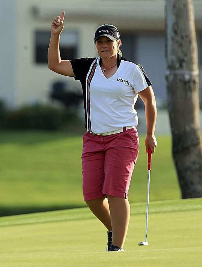 RANCHO MIRAGE, CA - APRIL 03: Karen Stupples of England acknowledges the crowd as she leaves the 18th green as the third round leader at the end of play in the third round of the 2010 Kraft Nabisco Championship, on the Dinah Shore Course at The Mission Hills Country Club, on April 3, 2010 in Rancho Mirage, California. Photo: David Cannon, Getty Images