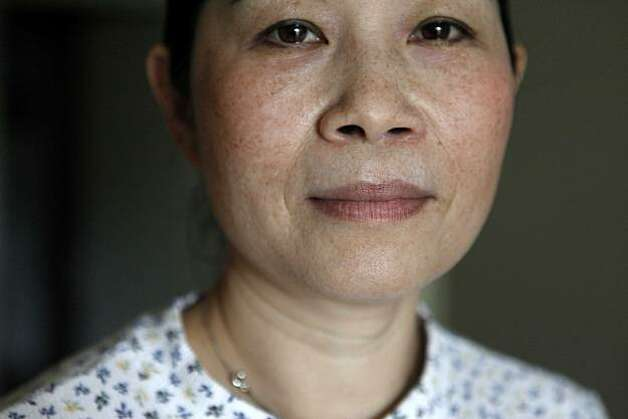 "Haddie Lin, who has been a housekeeper at the Grand Hyatt for 14 years, stands for a portrait in her apartment on Tuesday March 23, 2010 in San Francisco, Calif. Lin, a single mother soon thinks she may soon be settled with college bills for her son says she 's very concerned with potential rising costs of health care benefits. ""Even just $10 a month I have to budget for,"" she said. ""Every penny counts. If I need to pay an increase I have to cut another expense."" Photo: Mike Kepka, The Chronicle"