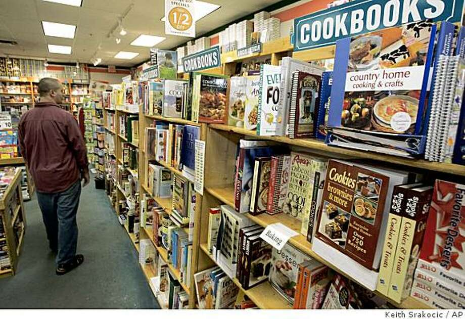 **FOR USE WITH AP LIFESTYLES**   A man walks down the aisle past the cookbooks at a bookstore in a mall in Grove City, Pa., Friday, Sept. 5, 2008. Due to rising fuel and food costs, more people are cooking meals at home rather than eating out, a growing trend that has helped boost sales of cookbooks, according to recent surveys.    (AP Photo/Keith Srakocic) Photo: Keith Srakocic, AP