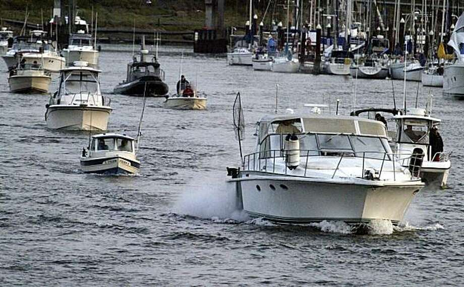 Sport fishing boasts leave the Santa Cruz Small Craft Harbor on Saturday as sport salmon season opens after a two-year absence. Photo: Bill Lovejoy, AP