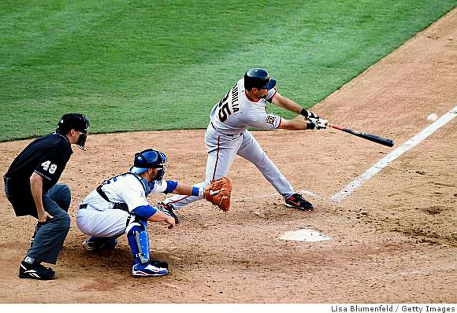 LOS ANGELES, CA - SEPTEMBER 21:   Rich Aurilia #35 of the San Francisco Giants hits a RBI single in the 11th inning against the Los Angeles Dodgers at Dodger Stadium on September 21, 2008 in Los Angeles, California.  The Giants defeated the Dodgers in 11 innings.  (Photo by Lisa Blumenfeld/Getty Images) Photo: Getty Images