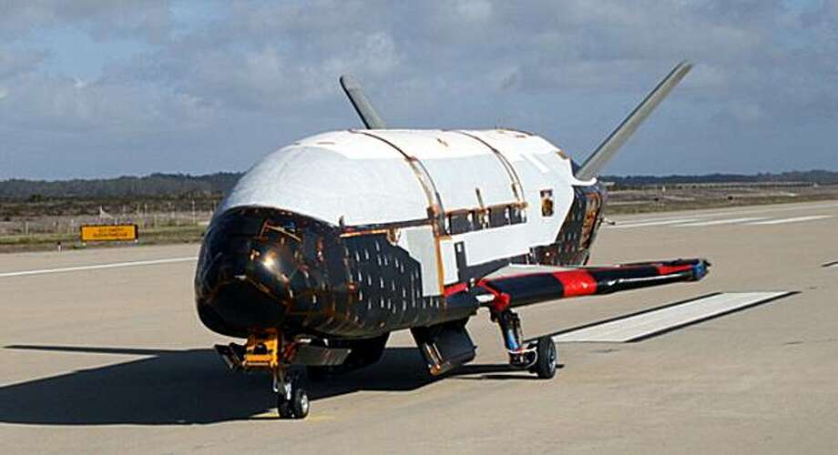 This undated image released by the U.S. Air Force shows the X-37B spacecraft. The Air Force is preparing to launch this robotic spacecraft that resembles a small space shuttle to perform unspecified technology tests in orbit and then autonomously glide onstubby wings to a landing on a California runway. Originally intended to be launched from a space shuttle, the reusable X-37B Orbital Test Vehicle has been a decade in development. Photo: AP