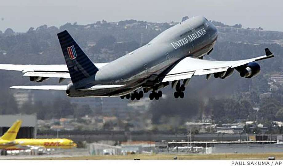 United Airlines said on Wednesday it is on track to lose $544 million on fuel hedges this quarter. **FILE** A United Airlines plane leaves San Francisco International Airport, in this July 31, 2006 file photo. United Airlines intends to expand about 15 percent internationally over the next three years but has no interest in growing its domestic operations in the current challenging marketplace, a senior executive of the carrier said Tuesday, Dec. 4, 2007. (AP Photo/Paul Sakuma, file) Ran on: 12-05-2007 United Airlines intends to expand about 15 percent overseas in the next three years but has no interest in growing its domestic operations, a senior executive said. Photo: PAUL SAKUMA, AP