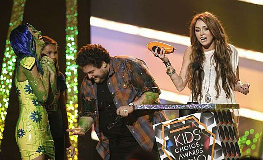 Miley Cyrus accepts the award for favorite movie actress as presenters Katy Perry, left, and Jonah Hill look on at Nickelodeon's 23rd Annual Kids' Choice Awards on Saturday, March 27, 2010, in Los Angeles. Photo: Matt Sayles, AP