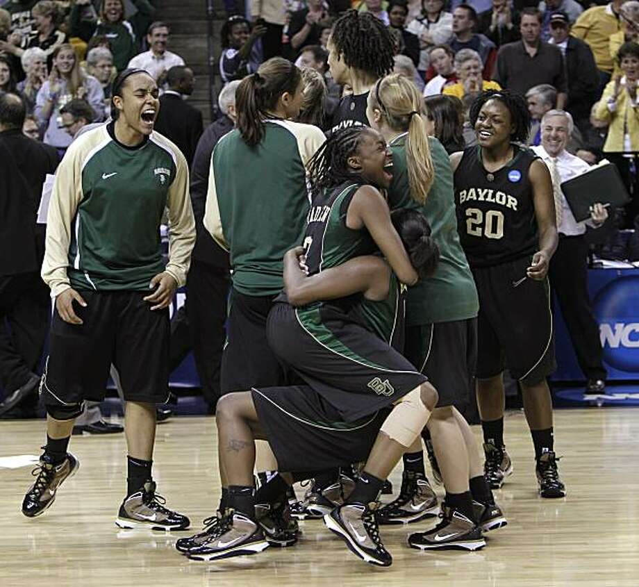 Baylor guard Jordan Madden, front left, hugs guard Kimetria Hayden after beating Duke 51-48 in the NCAA Memphis Regional championship college basketball game Monday, March 29, 2010, in Memphis, Tenn. Baylor advances on to the Final Four with the win. Photo: Mark Humphrey, AP