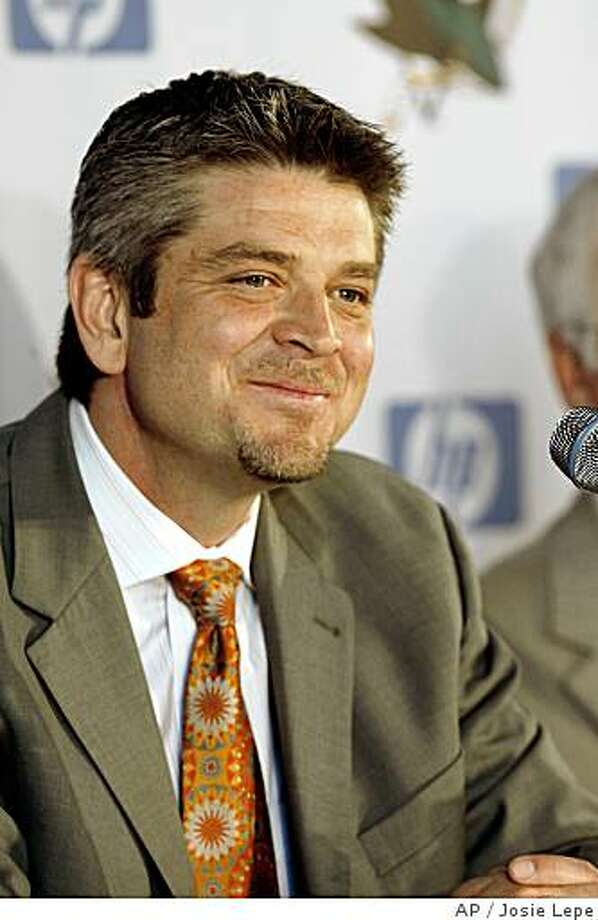 The San Jose Sharks' new coach, former Detroit Red Wings assistant coach, Todd McLellan, smiles as a news conference at HP Pavilion in San Jose on Thursday, June 12, 2008. (AP Photo/San Jose Mercury News, Josie Lepe) **MAGS OUT, NO SALES** Photo: Josie Lepe, AP