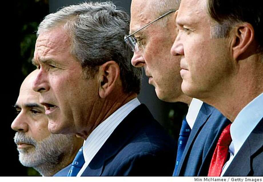 WASHINGTON - SEPTEMBER 19:  U.S. President George W. Bush (2nd L), flanked by (L-R) Federal Reserve Chairman Ben Bernanke, U.S. Treasury Secretary Henry Paulson and  SEC Chairman Christopher Cox, speaks about a plan by the federal government to try and shore up failing financial markets September 19, 2008 in Washington, DC. The plan would attempt to stabilize money market mutual funds, absorb bad debt held by mortgage companies, and ban short selling of financial company stocks.   (Photo by Win McNamee/Getty Images) Photo: Win McNamee, Getty Images