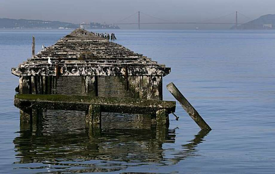 Decaying remnants of the old Municipal Pier stretches out towards the Golden Gate in Berkeley, Calif., on Tuesday, March 23, 2010. During its heyday, the pier extended 3.5 miles out into San Francisco Bay but now only 3,000 feet of it is accessible for fishing and foot traffic. Photo: Paul Chinn, The Chronicle