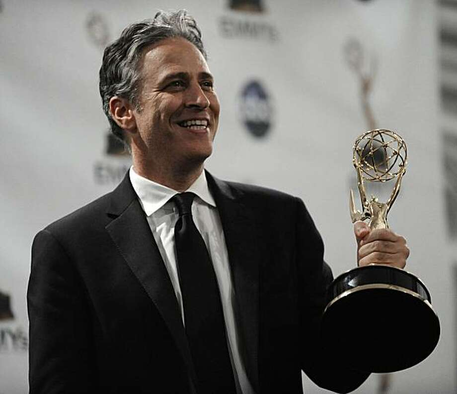 "Jon Stewart holds the award for the outstanding variety, music or comedy series for ""The Daily Show with Jon Stewart"" at the 60th Primetime Emmy Awards Sunday, Sept. 21, 2008, in Los Angeles. Photo: Chris Pizzello, AP"