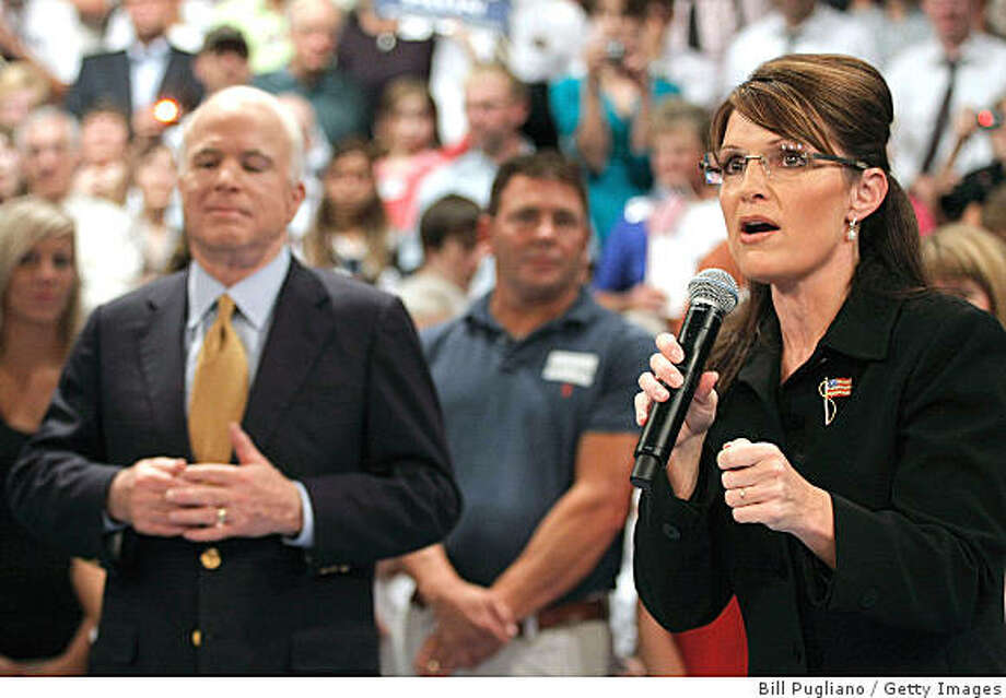GRAND RAPIDS, MI - SEPTEMBER 17:  Republican presidential nominee Sen. John McCain of Arizona and his vice-presidential running mate Gov. Sarah Palin of Alaska hold a Town Hall meeting at Grand Rapids Community College September 17, 2008 in Grand Rapids, Michigan. Currently, McCain is leading his opponent U.S. Sen. Barack Obama (D-IL) in the polls.  (Photo by Bill Pugliano/Getty Images) Photo: Bill Pugliano, Getty Images