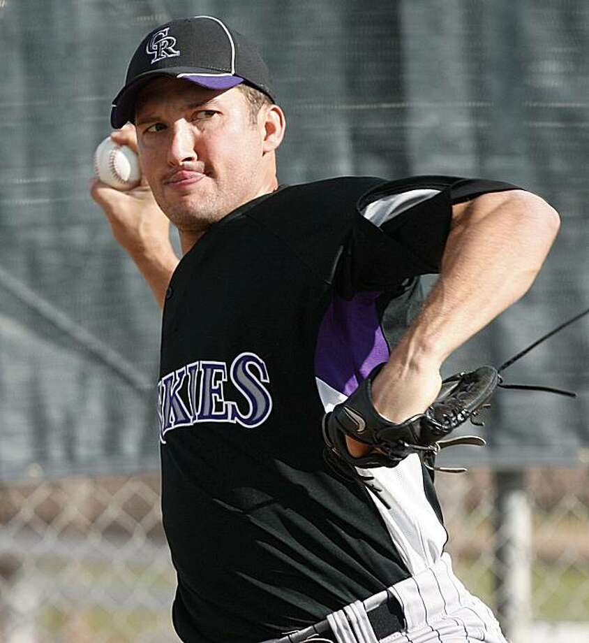 In this photo taken on Sunday, Feb. 21, 2010, Colorado Rockies pitcher Huston Street throws from the mound during baseball spring training in Tucson, Ariz. Street has not worked out with the team in four days because of a sore shoulder. Photo: Ed Andrieski, AP