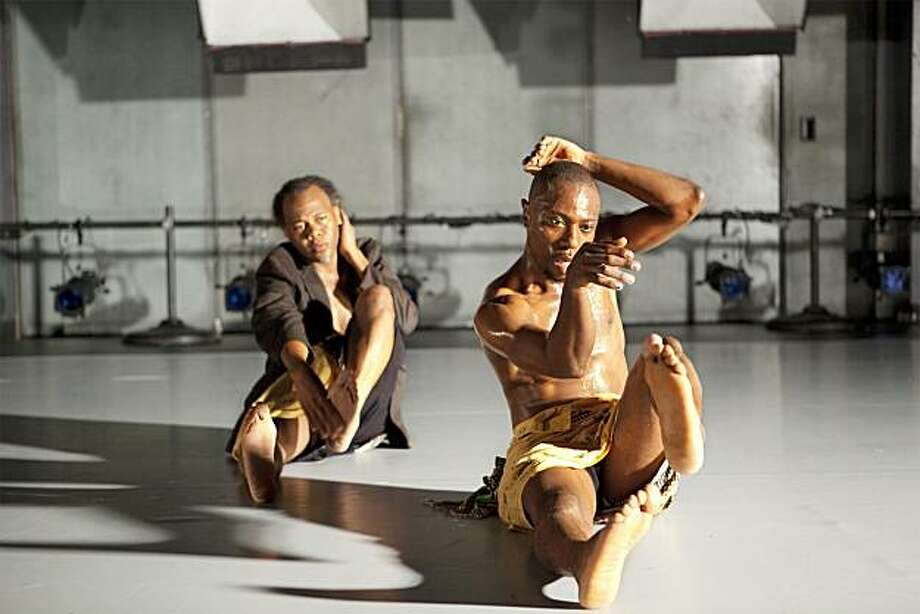 Dancers on the floor in motion (left to right): Reggie Wilson and Andreya Ouamba  The Good Dance- dakar-brooklyn credit Antoine Temp? Photo: Antoine Tempé