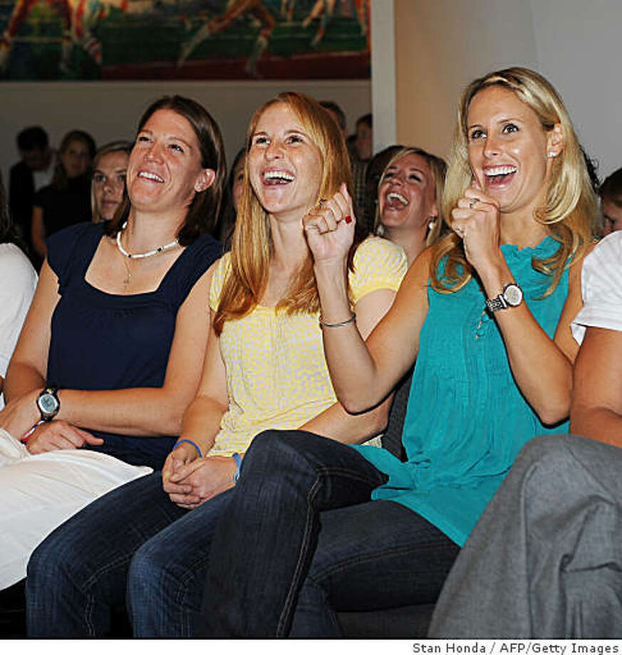 Soccer players Nicole Barnhart (L), Rachel Buehler (2nd L), Leslie Osborne (2nd R) and Abby Wambach (R) of the U.S. Women's National Team cheer as they watch a video of their 2008 Olympic gold medal performance on September 16, 2008 at the Sports Museum of America in New York. Women?s Professional Soccer (WPS) announced the allocations of the U.S. Women?s National Team to its seven franchises, Barnhart, Buehler and Osborne will play for the Bay Area and Wambach for Washington, D.C. The league will start play in spring of 2009. Photo: Stan Honda, AFP/Getty Images