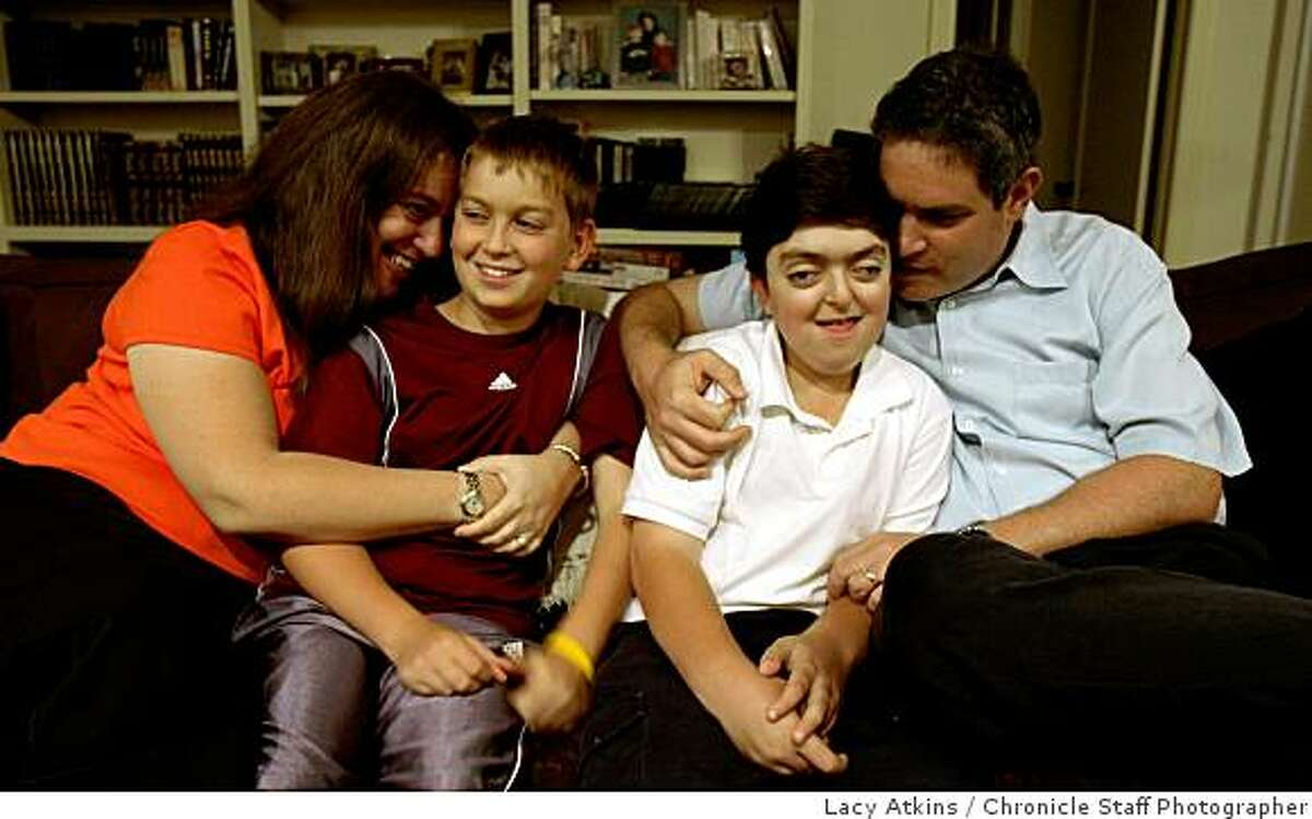 Lisa Wise with sons, Joshua and Michael, and husband, Steven Weinger, are seen in their Palo Alto home. Wise and her family are pushing for Prop 3, a bond initiative to raise funds for children's hospitals in California.