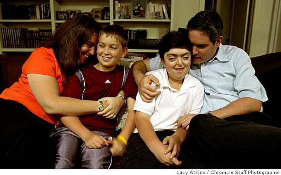 Lisa Wise with sons, Joshua and Michael, and husband, Steven Weinger, are seen in their Palo Alto home.  Wise and her family are pushing for Prop 3, a bond initiative to raise funds for children's hospitals in California. Photo: Lacy Atkins, Chronicle Staff Photographer
