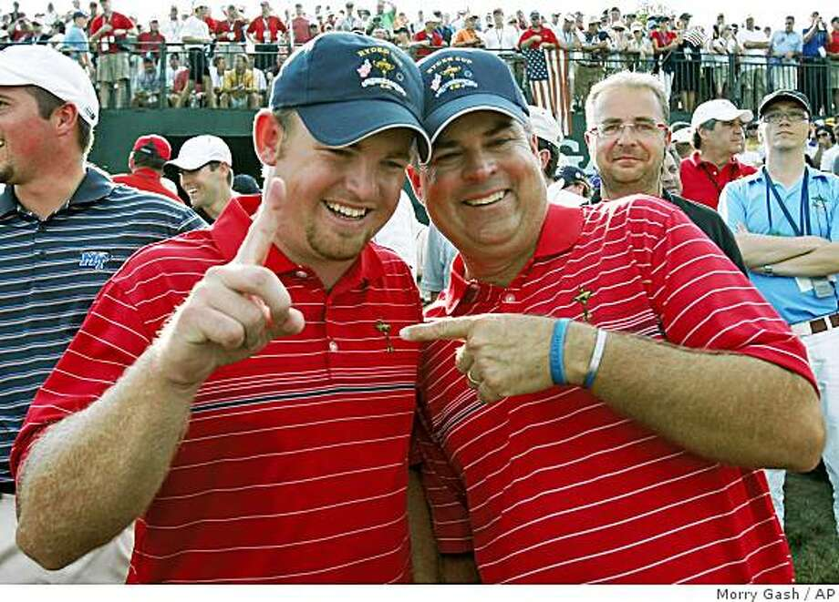 Team USA's J.B. Holmes, left and Kenny Perry celebrate the United States victory in the Ryder Cup at the Valhalla Golf Club, in Louisville, Ky., Sunday, Sept. 21, 2008. Photo: Morry Gash, AP