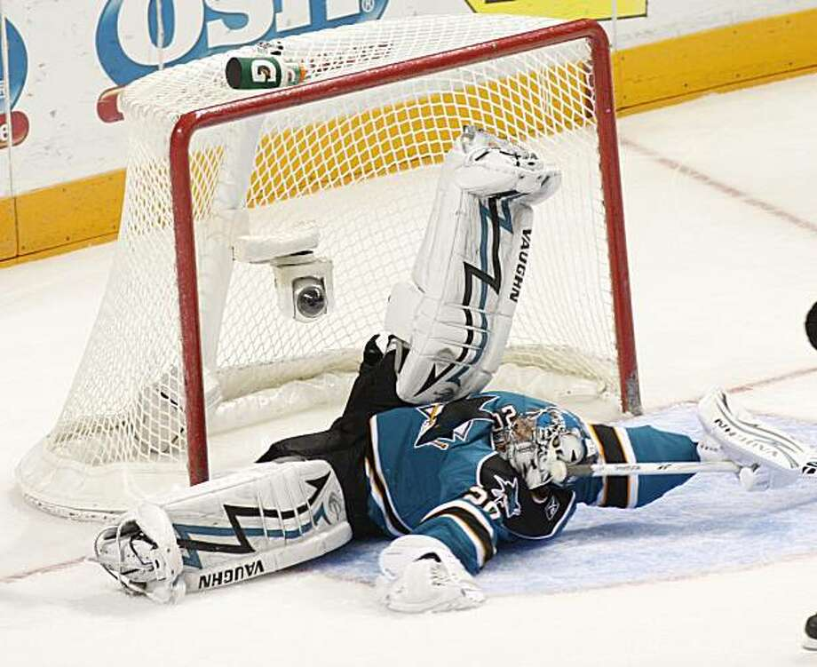 San Jose Sharks goalie Evgeni Nabokov blocks a shot from the Vancouver Canucks during the third period of an NHL hockey game, Saturday, March 27, 2010 in San Jose, Calif. The Sharks beat the Canucks 4-2. Photo: George Nikitin, AP