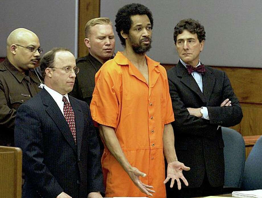 Convicted sniper John Allen Muhammad, center, addresses the court along with his attorney's Peter Greenspun, left, and Jonathan Shapiro prior to being sentenced to death for the shooting of Dean Meyers at the Prince William County Circuit Court in Manassas, Va., Tuesday March 9, 2004. Photo: Steve Helber, AP