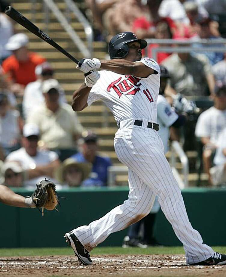 Minnesota Twins' Jacque Jones hits a two-run home run off a pitch by Florida Marlins' Anibal Sanchez during the third inning of a spring training baseball game in Fort Myers, Fla., Wednesday, March 24, 2010. The Twins defeated the Marlins 4-1. Photo: Steven Senne, AP