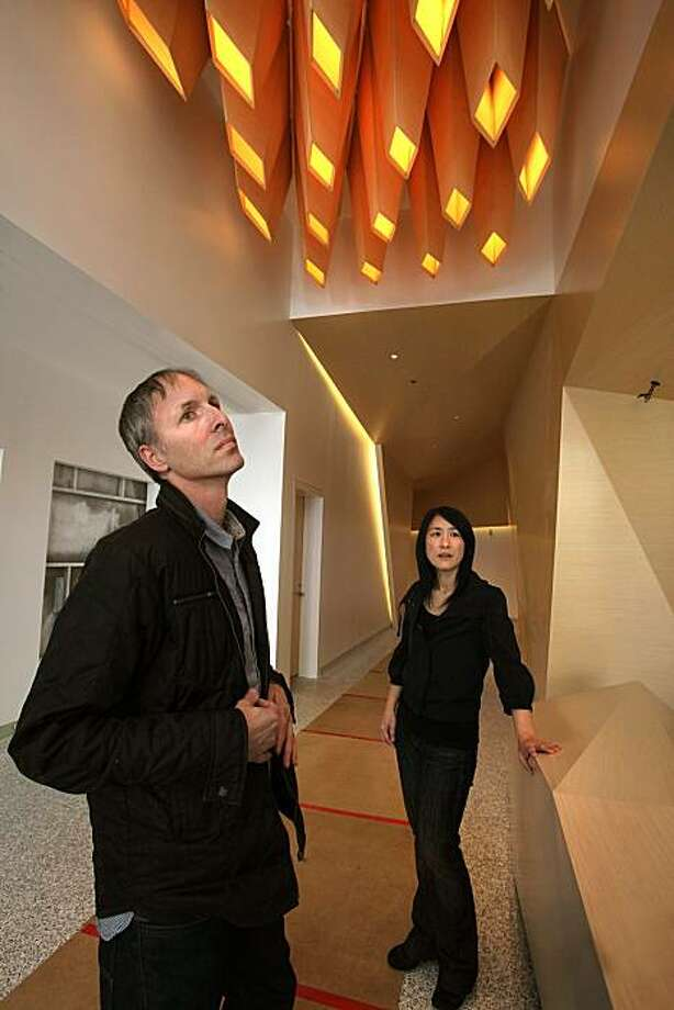 Architects Craig Scott and Lisa Iwamoto have handmade coffered overhead lighting, a custom made desk, and custom made walls with recess lighting in the lobby of their first downtown San Francisco project in progress at One Kearny on Tuesday, March 23, 2010. Photo: Liz Hafalia, The Chronicle