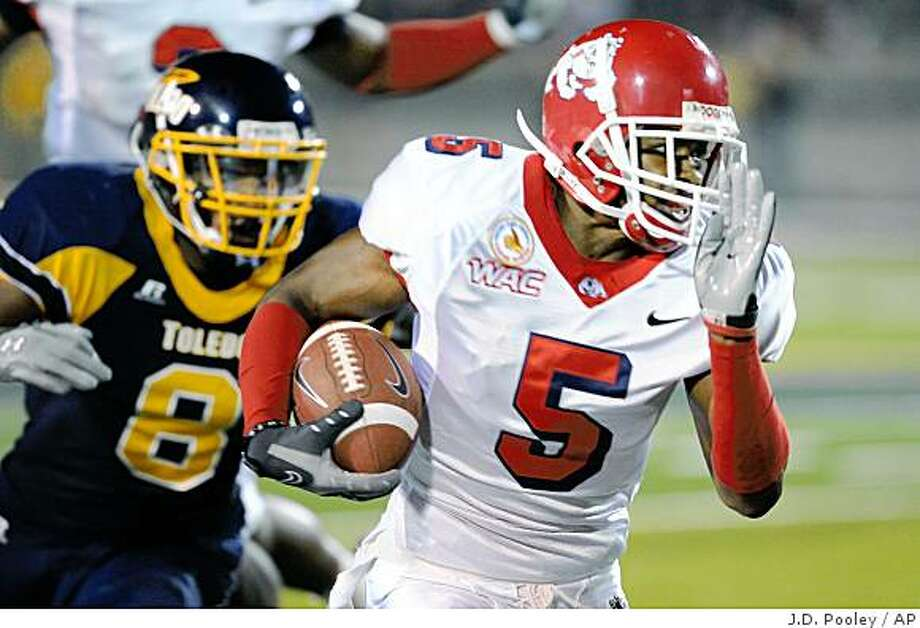 Fresno State's Marlon Moore (5) runs the ball past Toledo's Barry Church during the first half of an NCAA college football game Saturday, Sept. 20, 2008, in Toledo, Ohio. (AP Photo/J.D. Pooley) Photo: J.D. Pooley, AP